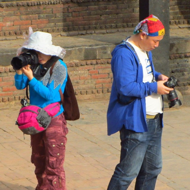 Tourists with large cameras